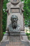 Dostoyevsky`s grave at the Tikhvin cemetery. stock photo