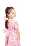 Dosyć śliczna młoda dziewczyna jest ubranym różowy smokingowy przyglądającego z powrotem obrazy royalty free