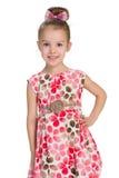 Dosyć uśmiechać się mała dziewczynka stojaki Zdjęcia Royalty Free