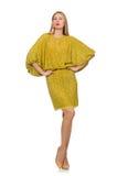 Dosyć wysoka kobieta w kolor żółty sukni odizolowywającej na zdjęcie stock