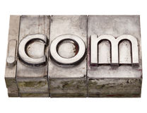 Dot com - internet domain in letterpress type Stock Images