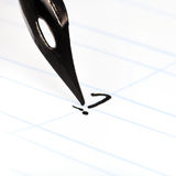 Dot the I by black ink in lined notebook Royalty Free Stock Photos