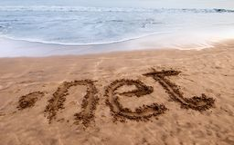 Dot net on the sand 2. Dot net written on sand near the sea Royalty Free Stock Photos