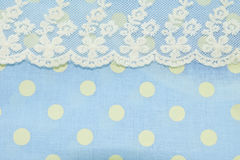 Dot pattern and lace on blue fabric texture. Royalty Free Stock Image