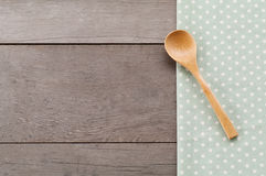Dot textile texture, wooden swooden spoons on wood textured background Stock Images