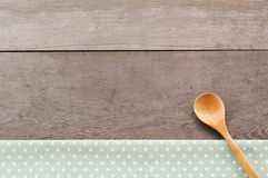 Dot textile texture, wooden swooden spoons on wood textured background. Dot textile texture, wooden spoons on wood textured background Royalty Free Stock Photos