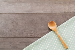 Dot textile texture, wooden swooden spoons on wood textured background Stock Photography