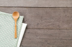 Dot textile texture, wooden swooden spoons on wood textured background Stock Photos