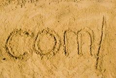 Dotcomslash im Sand Stockfotos
