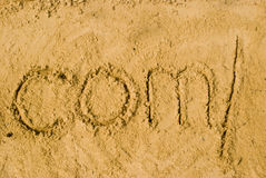Dotcomslash in sand Stock Photos