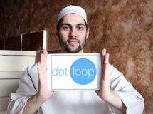 Dotloop logo. Logo of dotloop on samsung tablet holded by arab muslim man. dotloop is a transaction system that allows the paperwork associated with a multiparty Royalty Free Stock Photography