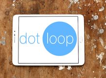 Dotloop logo. Logo of dotloop on samsung tablet on wooden background. dotloop is a transaction system that allows the paperwork associated with a multiparty real Stock Photography