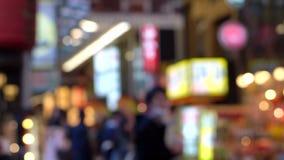 Dotonbori area shopping street and landmark at night blurry stock video