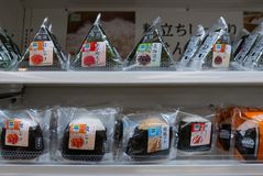 Various flavors of Japanese rice onigiri sold at Family Mart convenience outlet konbini in Osaka, Japan. DOTONBORI, OSAKA, JAPAN-NOVEMBER 9, 2018 : Various stock photography
