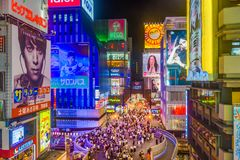Dotonbori Osaka Japan. OSAKA, JAPAN - AUGUST 16, 2015: Pedestrians walk below billboards in the Dotonbori district. The district is a popular tourist attraction Royalty Free Stock Image