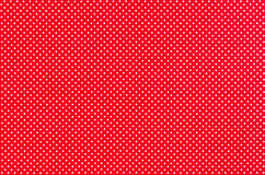 Dots Fabric. White dots over red Polka dot fabric background and texture royalty free stock photos