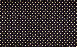 Dots fabric. Yellow dots over black fabric background and texture stock photos