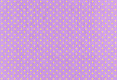 Dots Fabric. Yellow dots over purple Polka dot fabric background and texture stock images