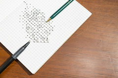Dots game. In notebook on wood texture royalty free stock images