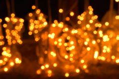 Dots of glittering lights. blurred lights. Some de focused lights together created a beautiful background stock photo