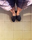 Dots of Light from Where I Stand. Person standing, feet together, in front of dots of light on tiled flooring stock photos