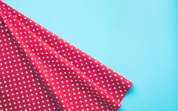Dots red fabric cloth with blue background. Royalty Free Stock Photos