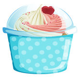 A dotted blue cupcake container Royalty Free Stock Images