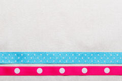 Dotted blue pink ribbon frame on white cloth Stock Photos