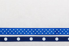 Dotted blue ribbon frame on white cloth Stock Photos