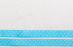 Dotted blue ribbon frame on white cloth Royalty Free Stock Photo