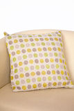 Dotted cushion. Dotted designed cushion on a sofa Stock Photography