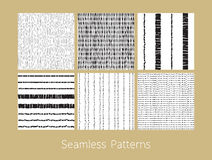 Dotted and Dashed Seamless Patterns Set. Set of dotted and dashed seamless patterns. Stylized burlap and matting abstract repeating textures in black and white Royalty Free Stock Photography