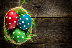 Dotted easter egg in basket Stock Photography