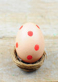 Dotted easter egg in nest Royalty Free Stock Image