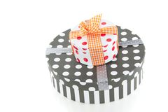 Dotted giftboxes with ribbons Stock Photos