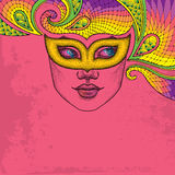 Dotted girl face in orange carnival mask Colombina and decorative colorful lace on the pink background. Royalty Free Stock Photography