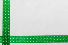 Dotted green blue ribbon frame on white cloth Royalty Free Stock Photography