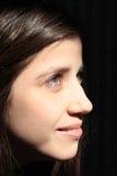 Dotted Hazel Eyes Smiling in Profile. A woman with hazel eyes in portrait stock photo