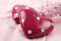 Dotted hearts. Two dotted hearts on pink background with hyacinth. Shallow dof Stock Images