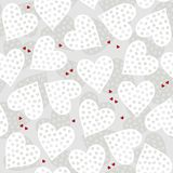 Dotted hearts on light gray. White and red dotted hearts on light patterned background romantic love related seamless pattern Royalty Free Stock Photos