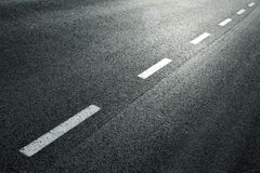 Dotted line on city asphalt road Stock Photo