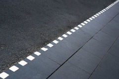 Dotted line on pavement. Sparse composition with dotted line on sidewalk Stock Image