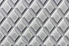 Dotted metal plate. Shiny steel. Royalty Free Stock Photo