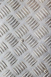 Dotted metal plate. Shiny steel. Stock Images
