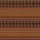 Dotted motifs in african style on brown background. Dotted motifs in african style over brown background Stock Image