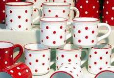 Dotted mugs. Red and white dotted mugs Royalty Free Stock Photography
