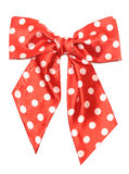 Dotted red satin gift bow Royalty Free Stock Photography