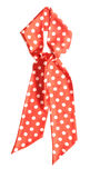 Dotted red satin gift bow Stock Image