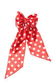 Dotted red satin gift bow Royalty Free Stock Images