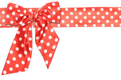Dotted red satin gift bow and ribbon Stock Photo
